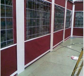 Toldos caída verrtical guías laterales ventanas PVC